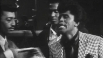 [James Brown on stage]
